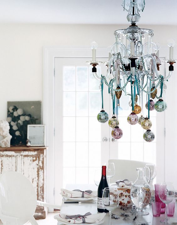 hang some pastel Christmas ornaments on yoru chandelier to make it cute and chic