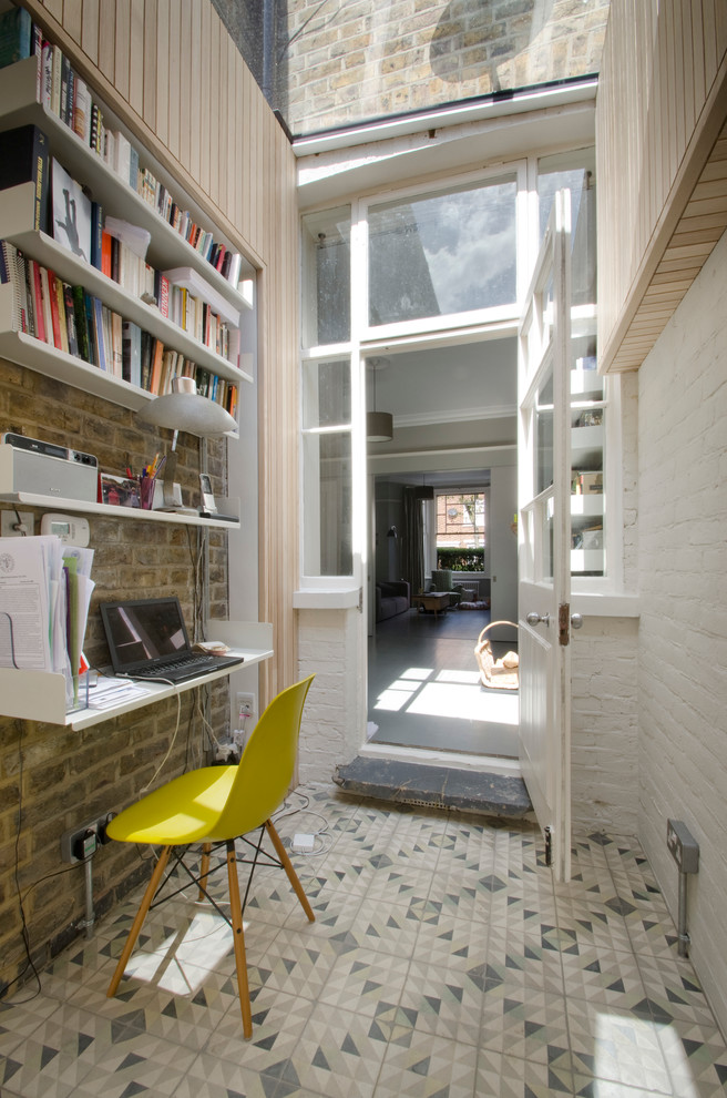 Patterned tiles and exposed brick walls are perfect decorating tools you could use for a home office.