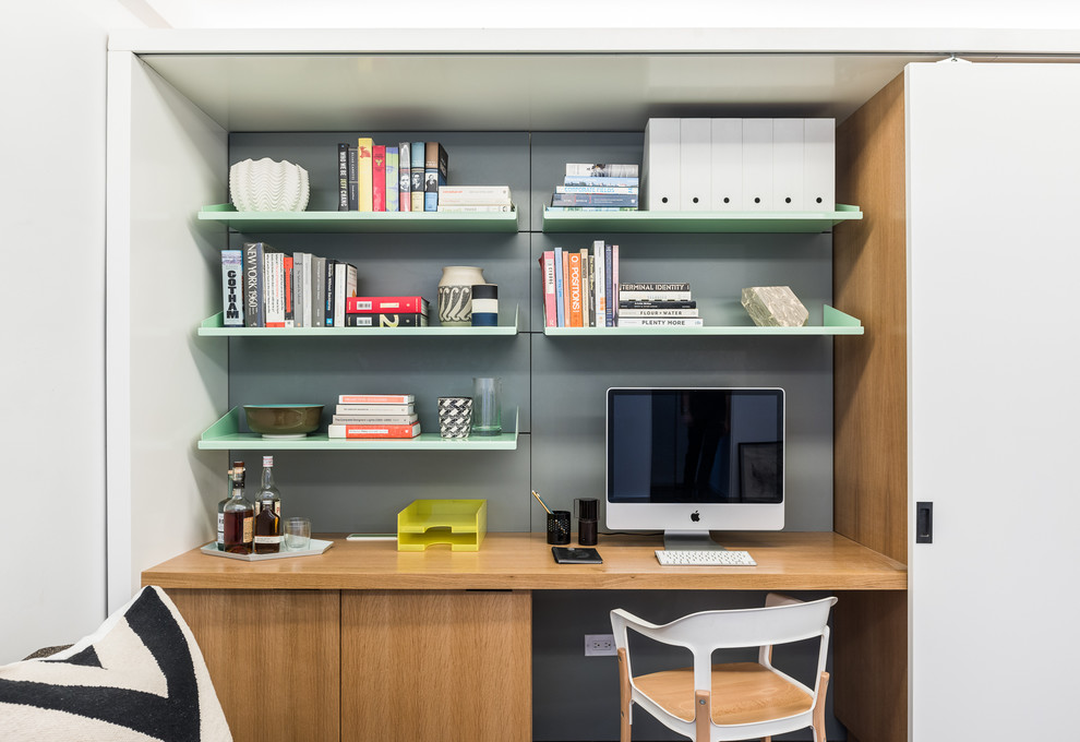 Make your home office a part of a storage wall for a more built-in look.