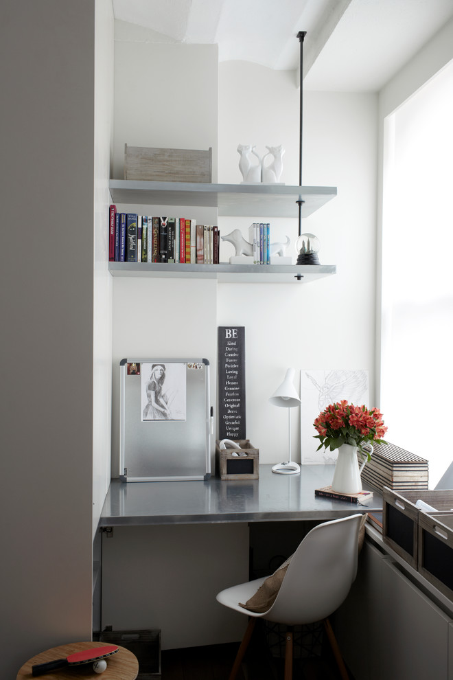 A corner deck and corner shelves might help to create a home office in a super awkward corner. (SchappacherWhite Architecture D.P.C.)