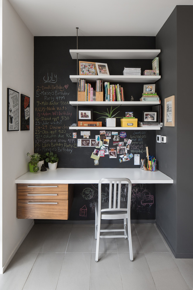 A contemporary black and white home office in a hallway. It features a chalkboard wall that is a perfect addition to any working space. (John Donkin Architect Inc.)