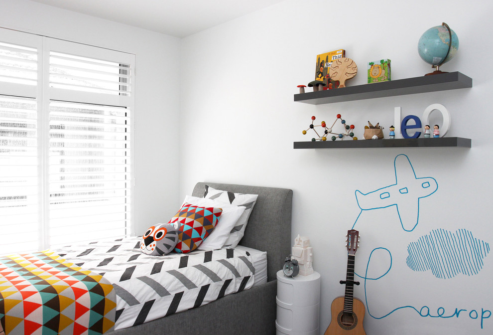 fun airplane mural is a simple yet cute way to decorate a wall