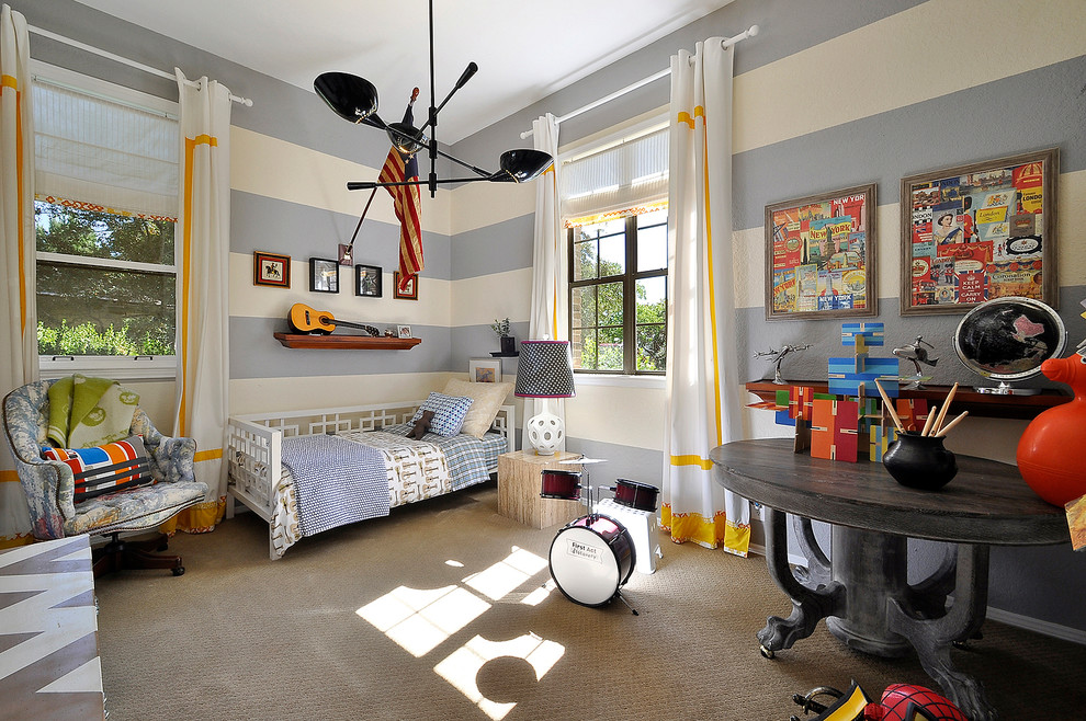 Grayish blue and cream walls provide a very nice background for bright yellow accents in this stylish boys' room.
