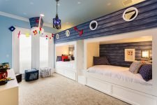 cute beach-inspired shared kids bedroom design with a cozy carpet