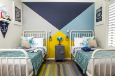 navy, sky blue and turquoise are used in this space in combination with a bright yellow splash