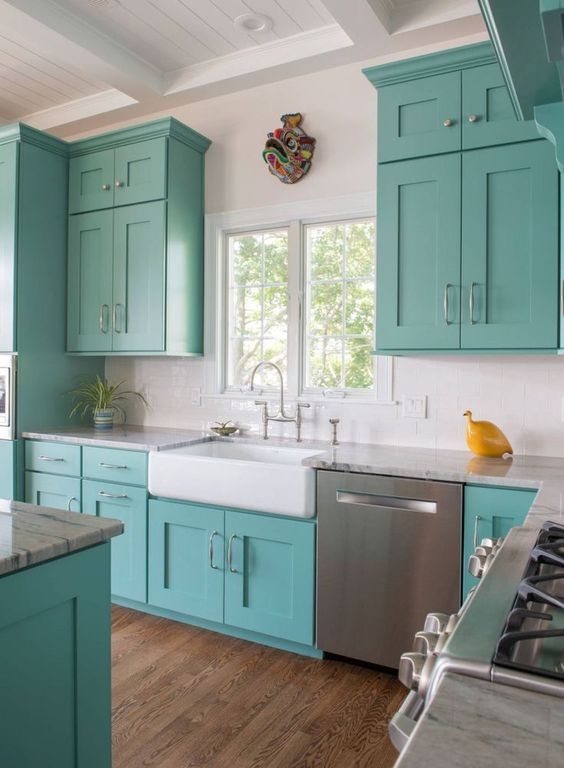 a fun turquoise and white kitchen with a yellow accent is a lovely idea for a beach house or just for a seaside home