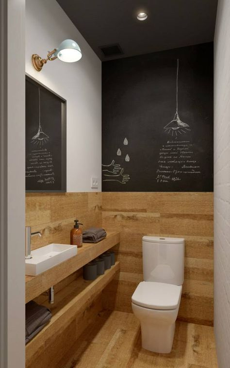 a small contemporary guest toilet with wood-inspired tiles and chalkboard, a vanity with open shelves and lights