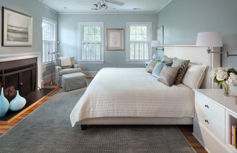 a modern bedroom done in a combo of light blue and grey all over, with some refreshing creamy touches