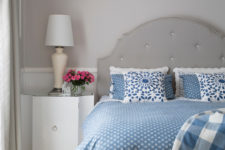 stylish modern classics – dove grey walls, curtains, floor and furniture and blue bedding on the bed