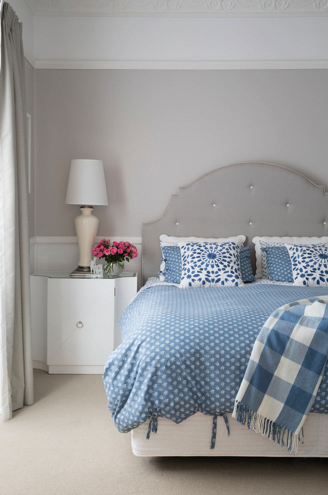 stylish modern classics   dove grey walls, curtains, floor and furniture and blue bedding on the bed