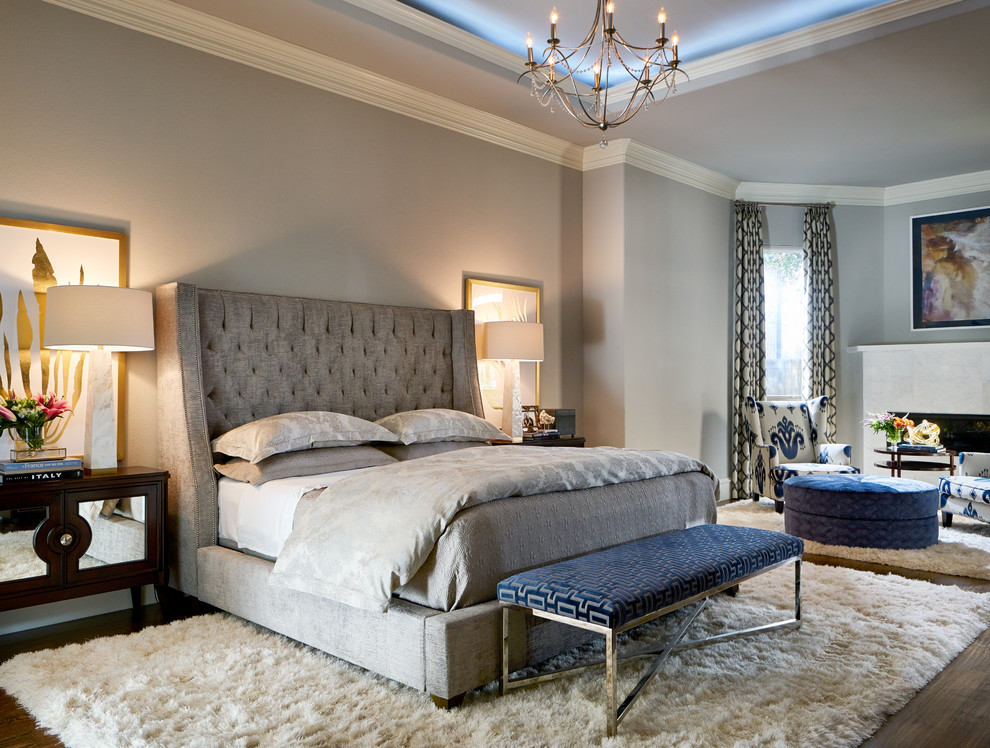 a light grey bedroom with much texture and a single navy accent   an upholstered bench
