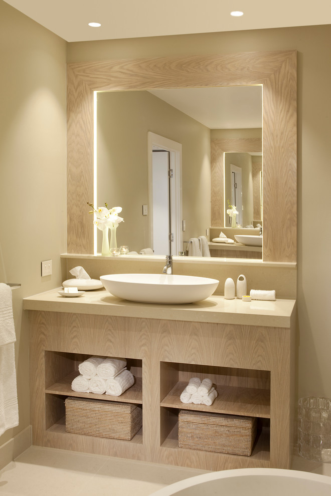 a soft taupe and beige bathroom with a large vanity plus a mirror and inner lights (apaiser)