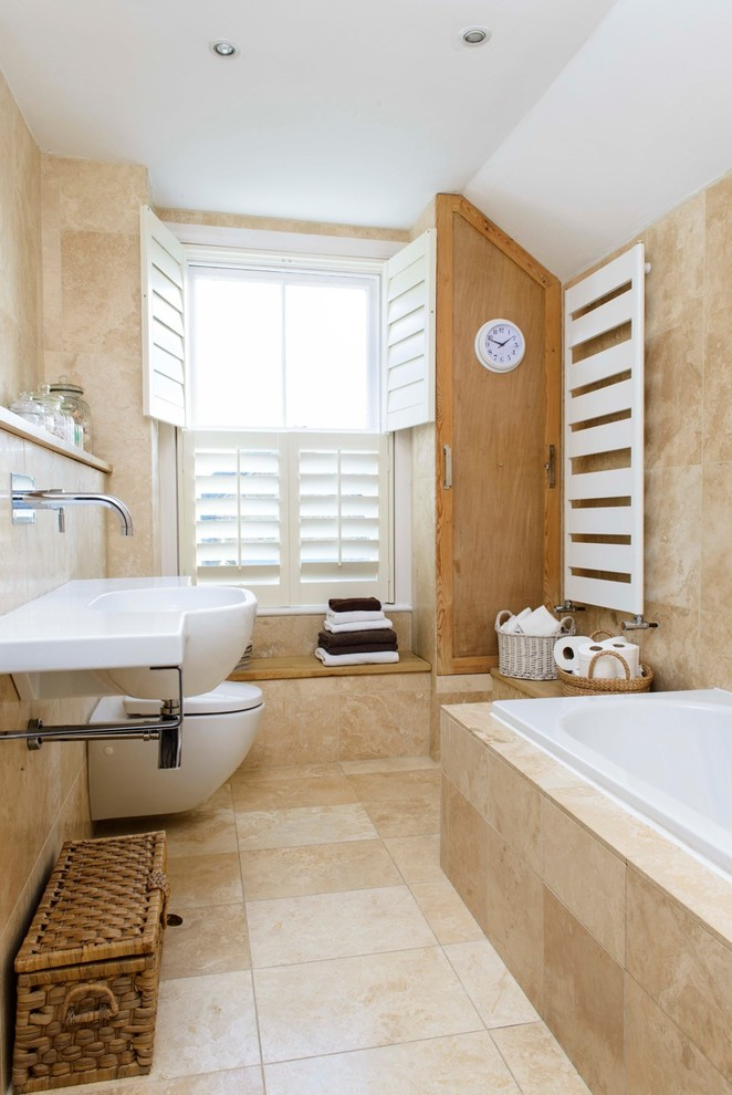 beige tiles with a stone-inspired print, white appliances and touches of vintage here and there (Whitstable Island Interiors)