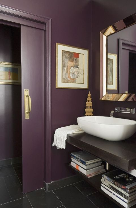 a chic purple bathroom, a floating vanity, metallic touches, a vessel sink and sliding doors