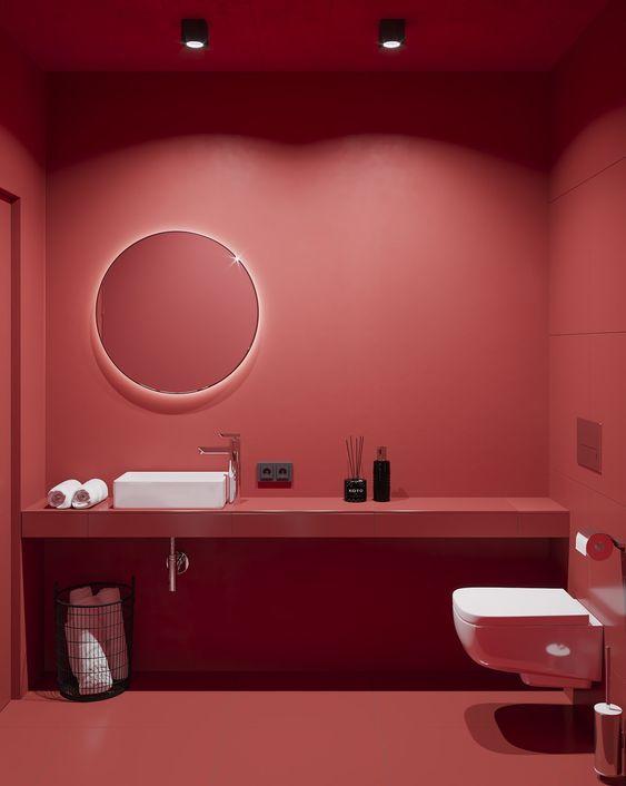 a super bold red powder room design