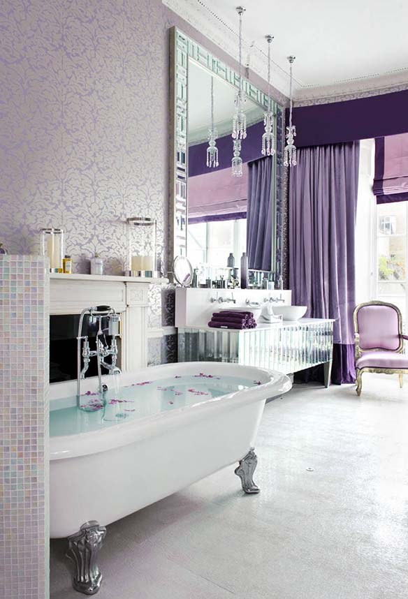 an exquisite bathroom in pastels and neutrals, with purple and lavender curtains, a statement mirror and crystal pendant lamps