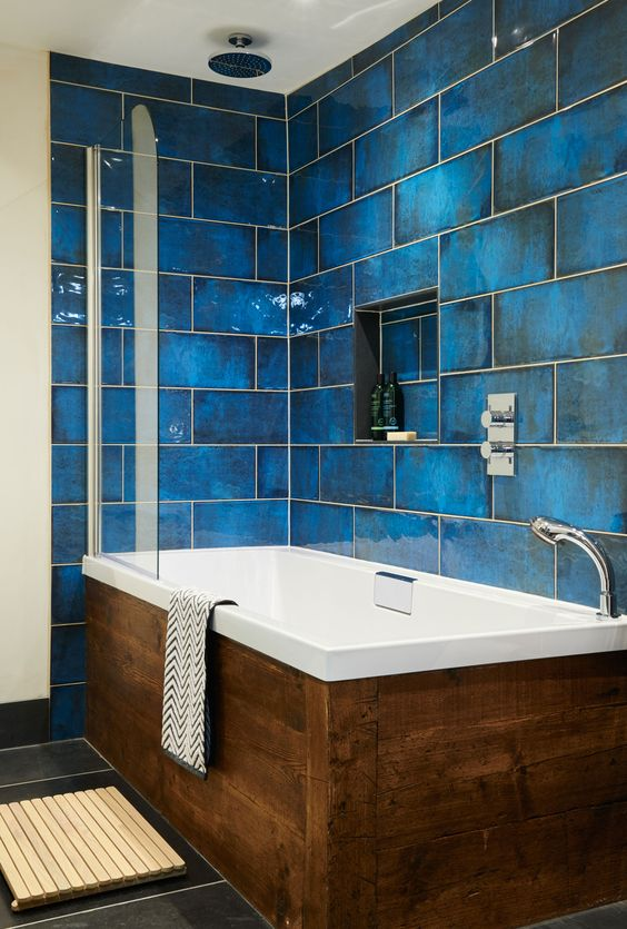 give your walls the the wow factor with intense blue and glossy finish, add a wooden clad bathtub
