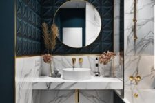 grey marble and teal geometric tles, gold elements and a round mirror for a luxurious and glam bathroom