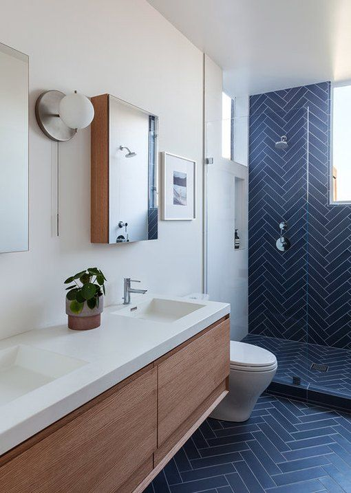 navy blue ceramic tiles in herringbone pattern on bathroom wall and floor for a contemporary rustic bathroom