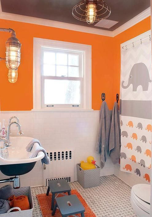 orange, grey and white make up an amazing color scheme for a kids' bathroom, add a fun print like here and go