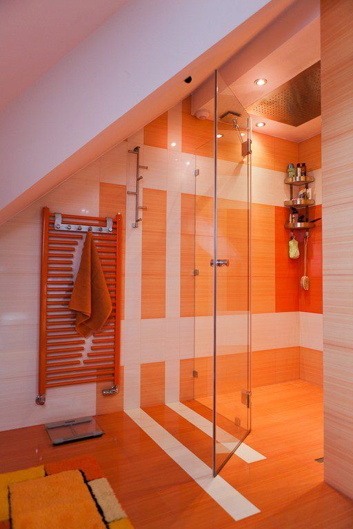 orange plus neutrals are a good color combo, build in more lights and go for some patterns with tiles for a chic look