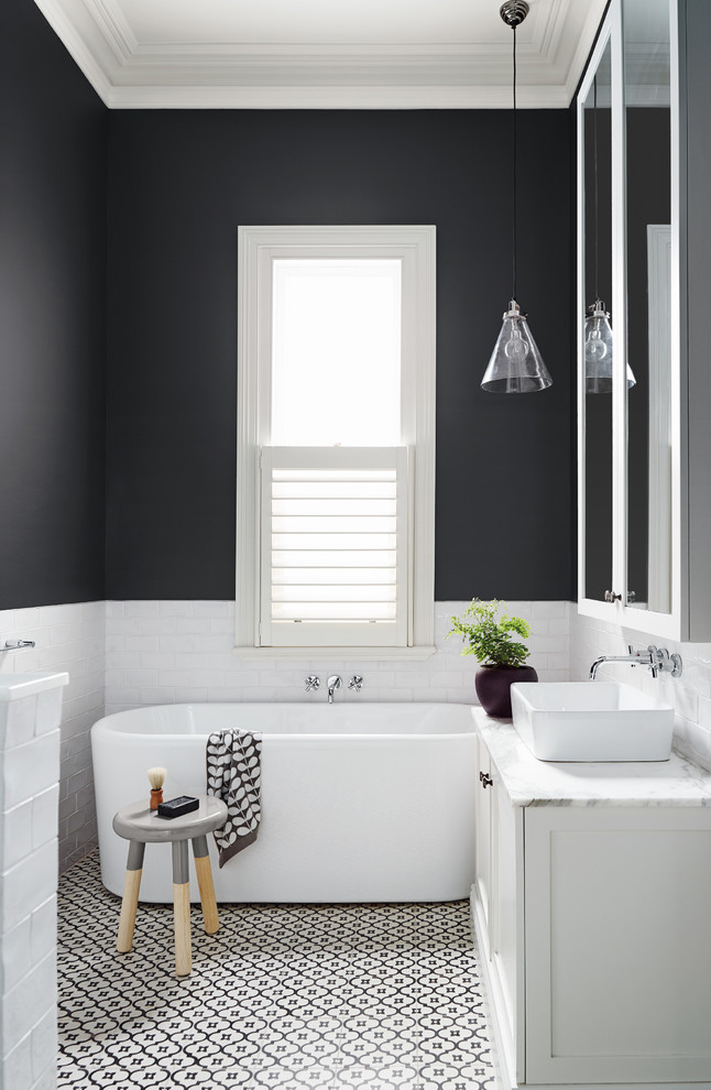 patterned black and white tiles on the floor is a great addition to this mid-sized bathroom