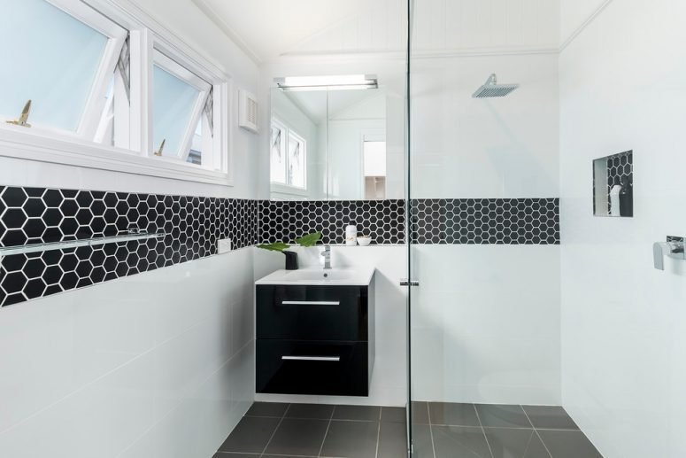 Epic small and trendy bathroom design with cool black hexagonal border tiles