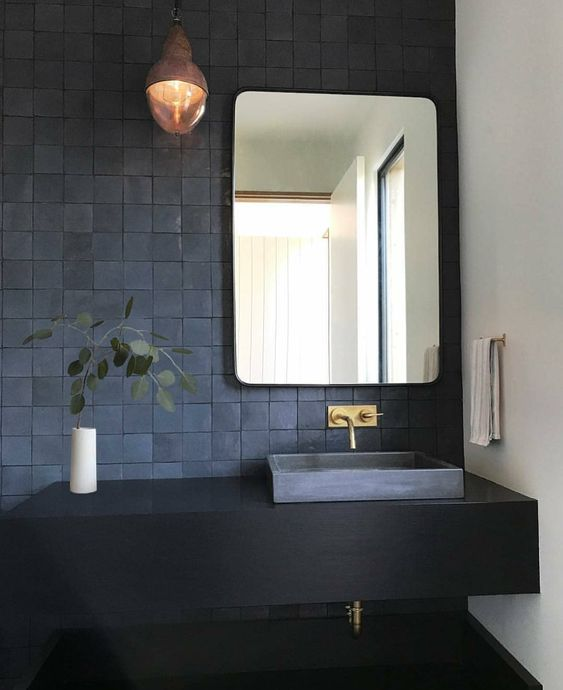 textural matte blue tiles and a black floating vanity for a laconic and very chic bathroom look