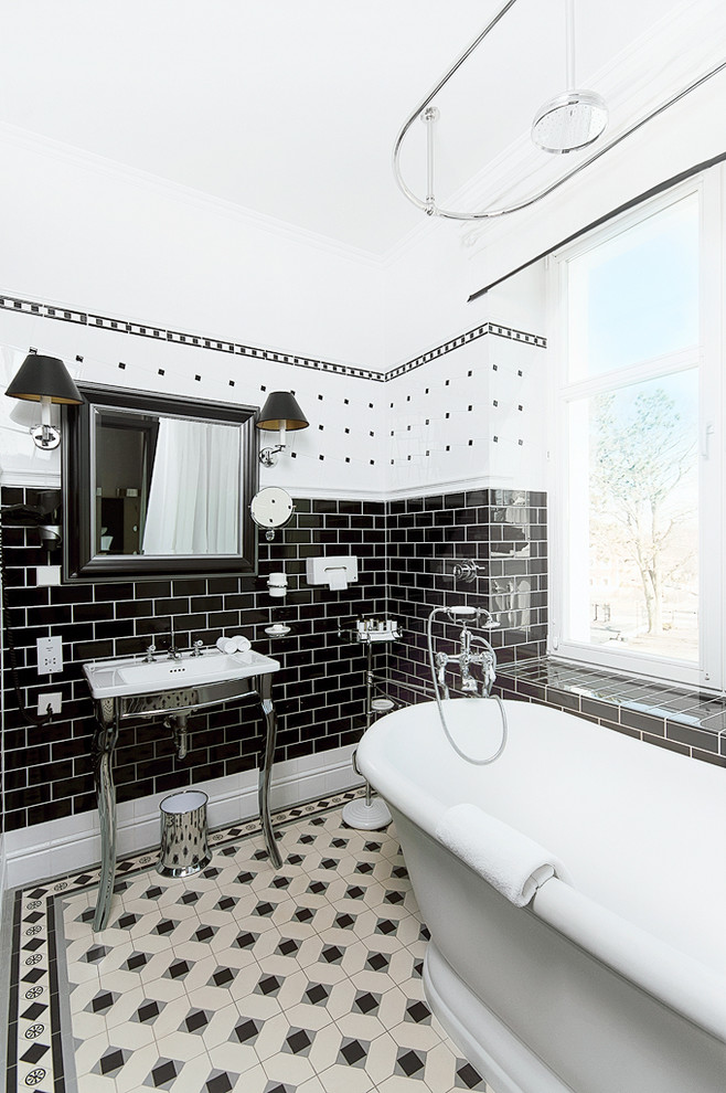 this bathroom proves that you can combine tiles in a lot of different patterns in one color theme