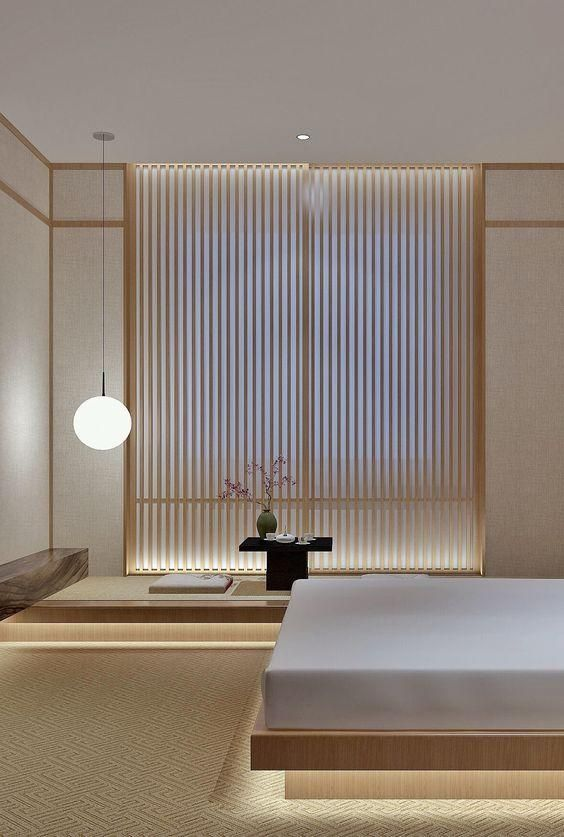 a Japandi bedroom with a wooden screen, low wooden furniture, built-in lights and a tea zone feels very zen-like