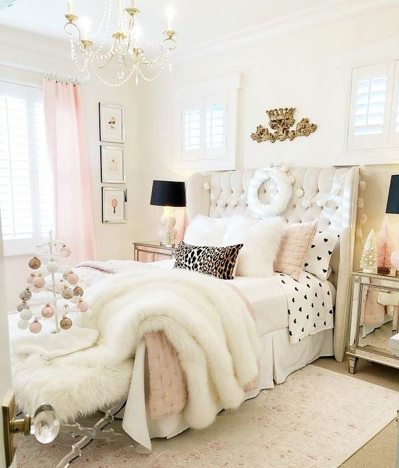 a refined glam bedroom in neutrals and pink, with black dramatic touches, gold items and faux fur