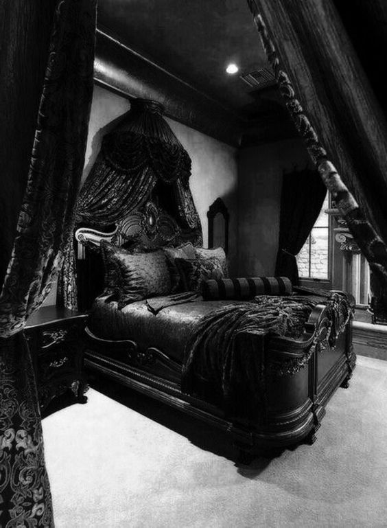 a super dark Gothic bedroom with grey walls and a floor, black furniture with a refined desogn, cnopies and draperies