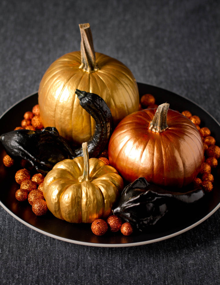 Paint your pumpkins with a shiny paint to add a warm glow to your decor.