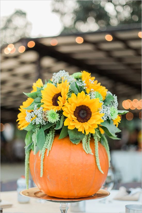 Sunflowers would look gorgeous on any table if you put them in a DIY pumpkin vase.