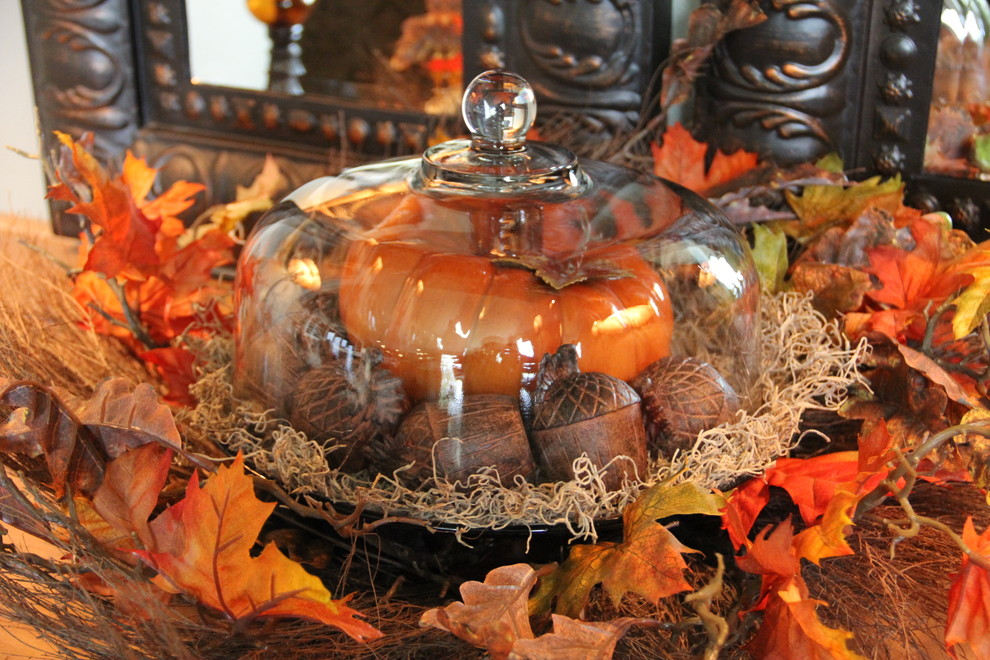 Use your cake stand to make a centerpiece. Fill it with yellow and red leaves, pumpkins, gourds, wooden acorns and any other products of harvest.