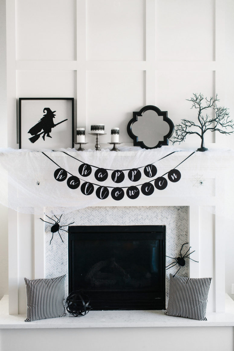 Black and white is a great color theme for a fireplace mantel decor.