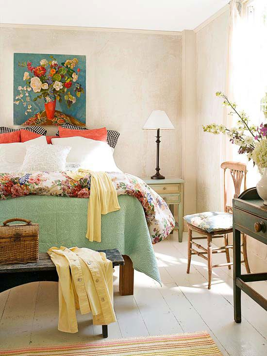 a bright fall bedroom with a neutral base and colorful details in greens, orange, rust and yellows