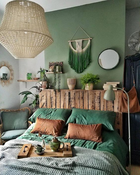 a bright fall boho bedroom done in the shades of grey, rust and stained wood looks amazing