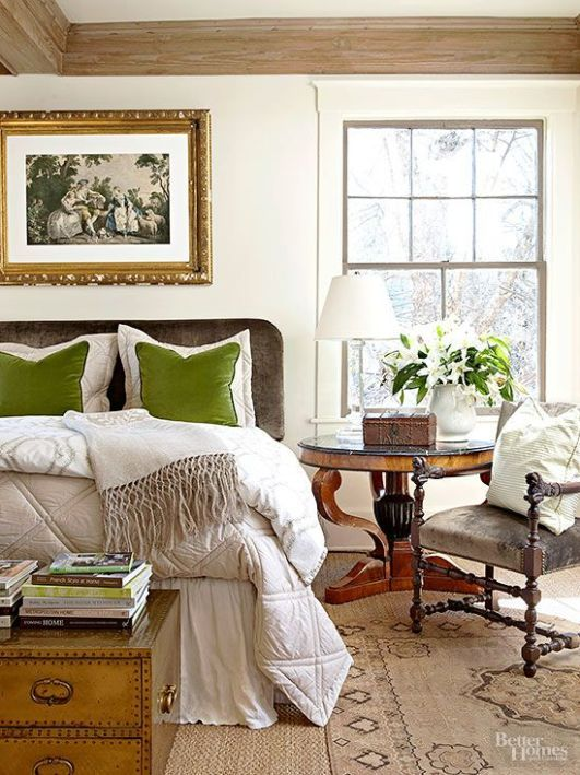 a neutral fall bedroom done in beige and creamy plus some touches of green and natural wood