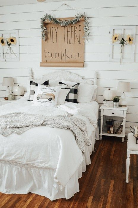 a neutral fall bedroom with touches of plaid, kraft paper and blooms in vases