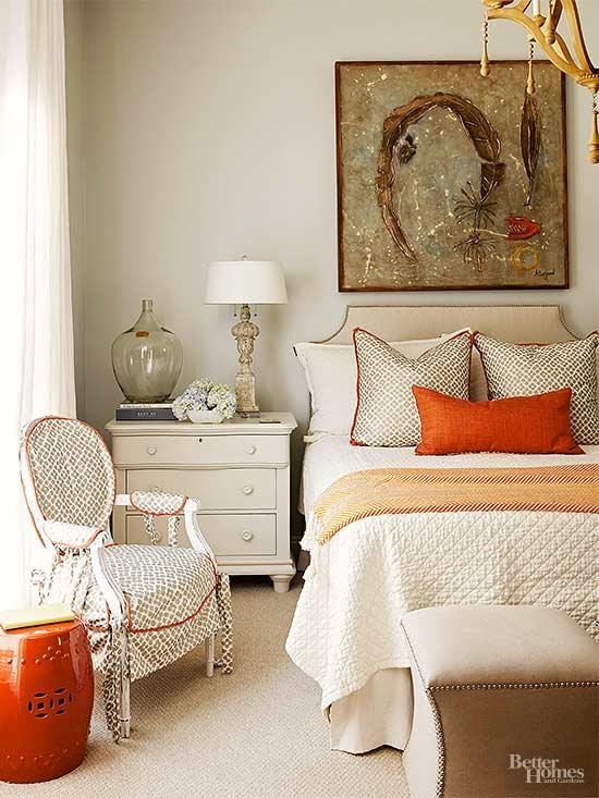 a refined fall bedroom done in creamy, grey, touches of rust and green for a fall feel