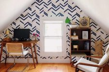 a cozy home office with chevron wall decor