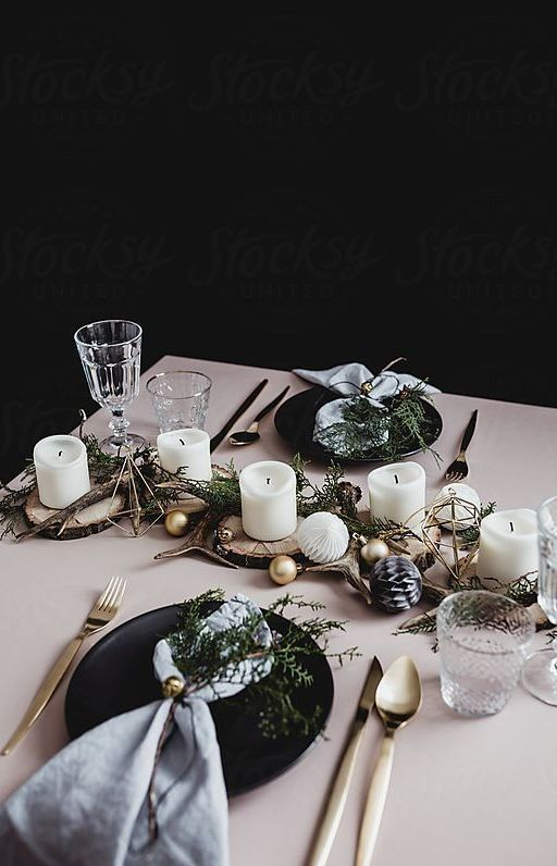 black plates, metallic cutlery, ornaments, wood slicesm branches, pillar candles paper balls