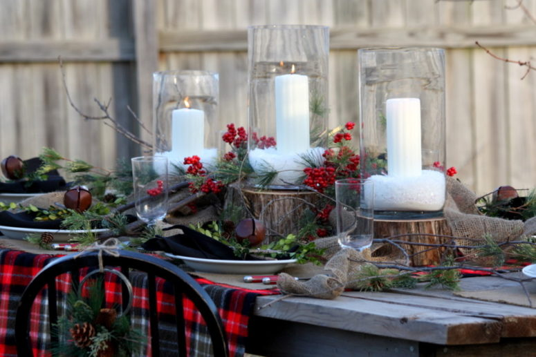 here is a gorgeous outdoor christmas table setting that might inspire you to organize something similar - Rustic Christmas Centerpieces
