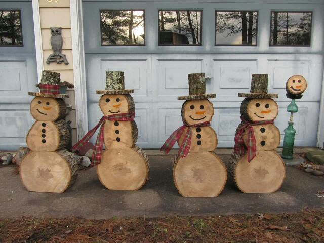 if youre cutting some trees this fall than save some round and make snowmen - Cool Outdoor Christmas Decorations