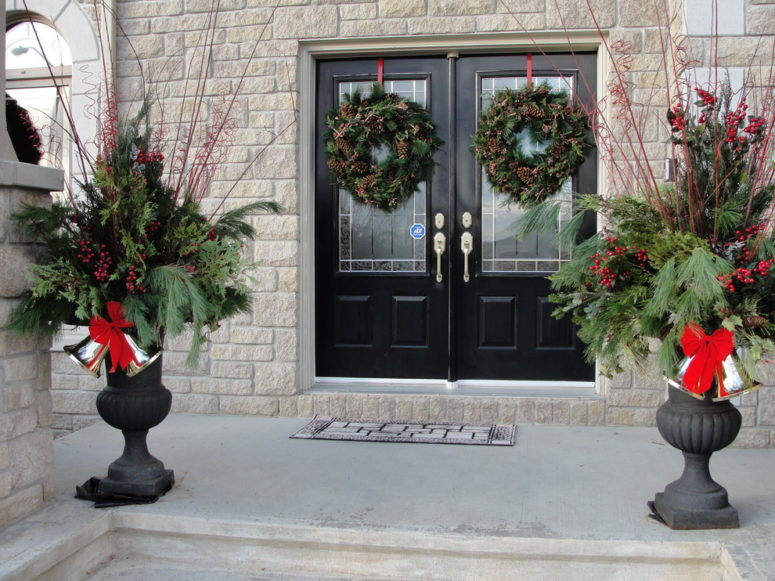 amazing outdoor christmas decorations two urns filled to the brim with seasonal boughs leaves and pine cones are