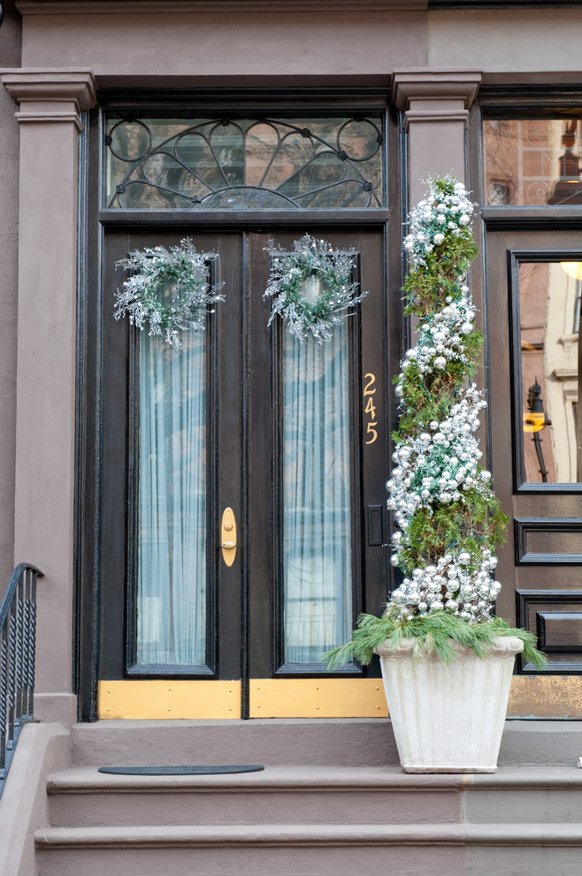 Add some ornaments to your entryway's topiary and you're ready for holidays!