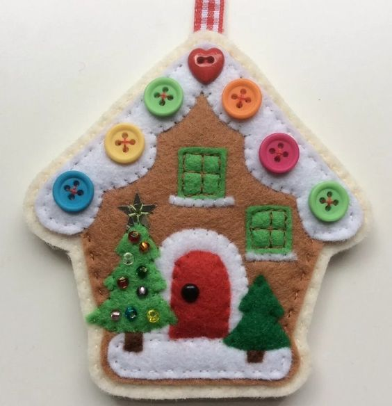 a colorful felt Christmas ornament with bright beads showing off a house with tiny Christmas trees is a lovely idea