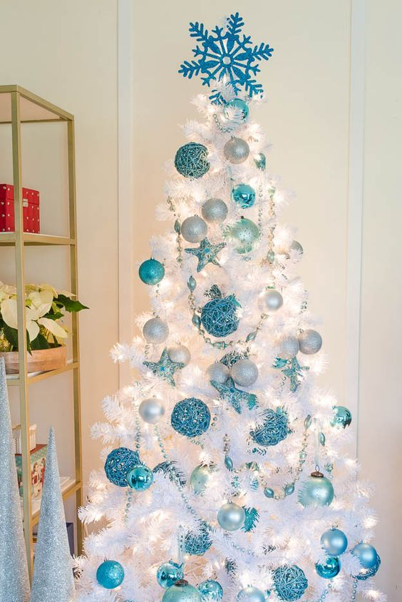 a pure white Christmas tree looks amazing with blue ornaments of various shades