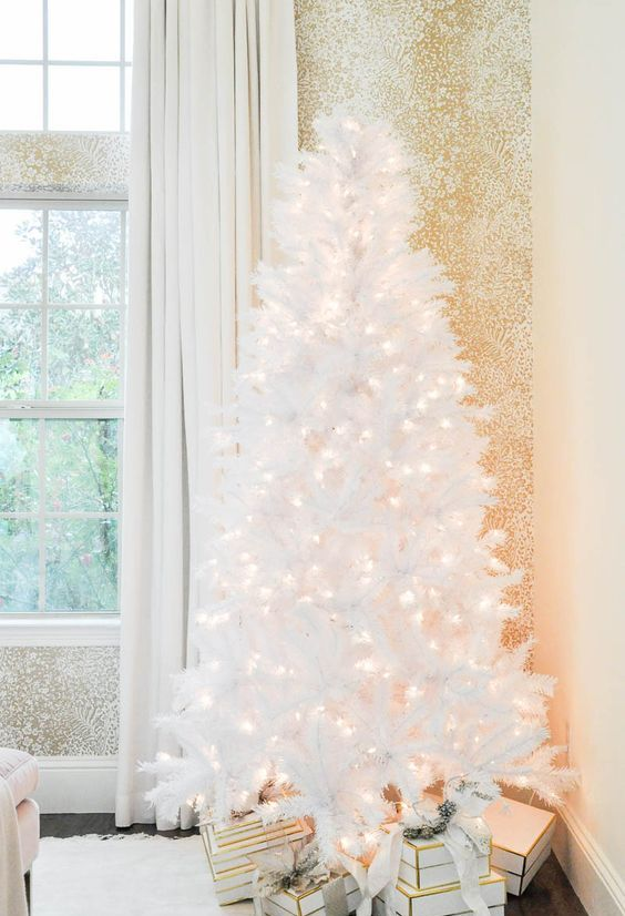 a pure white Christmas tree with LEDs looks very magical and will create a snowy fairy-tale in your home